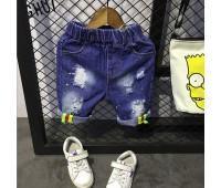 Джинсовые шорты  со сквозными потертостями